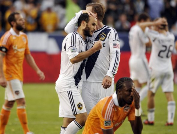 Dec 1, 2012; Los Angeles, CA, USA; Los Angeles Galaxy midfielder Landon Donovan (left) is greeted by teammate David Beckham (right) after a second half goal against the Houston Dynamo during the 2012 MLS Cup game at the Home Depot Center. Mandatory Credit: Robert Hanashiro-USA TODAY Sports
