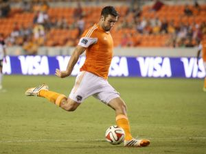 Jun 11, 2014; Houston, TX, USA; Houston Dynamo forward Will Bruin (12) shoots the ball during the second half against the Laredo Heat at BBVA Compass Stadium. Mandatory Credit: Andrew Richardson-USA TODAY Sports