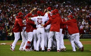 Oct 18, 2013; St. Louis, MO, USA; Members of the St. Louis Cardinals including Michael Wacha (52) celebrate on the field after game six of the National League Championship Series baseball game against the Los Angeles Dodgers at Busch Stadium. Image Credit: Scott Rovak-USA TODAY Sports