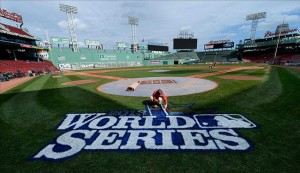 Oct 22, 2013; Boston, MA, USA; Chris Williams paints the World Series logo on the field during media day the day before game one of the 2013 World Series between the Boston Red Sox and St. Louis Cardinals at Fenway Park. Image Credit: Robert Deutsch-USA TODAY Sports