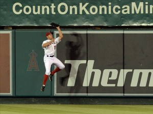 Jun 22, 2013; Anaheim, CA, USA; Los Angeles Angels center fielder Peter Bourjos (25) makes a catch against the wall in the ninth inning against the Pittsburgh Pirates at Angel Stadium.Pirates won 6-1. Image Credit: Jayne Kamin-Oncea-USA TODAY Sports