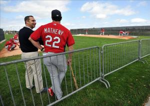 Feb 13, 2014; Jupiter, FL, USA; St. Louis Cardinals general manager John Mozeliak (left) talks with manager Mike Matheny (right) during spring training at Roger Dean Stadium. Image Credit: Steve Mitchell-USA TODAY Sports