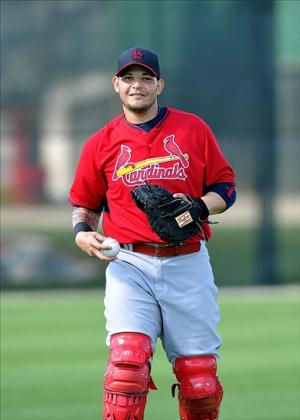Feb 15, 2014; Jupiter, FL, USA; St. Louis Cardinals catcher Yadier Molina (4) during spring training at Roger Dean Stadium. Image Credit: Steve Mitchell-USA TODAY Sports
