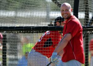 Feb 17, 2014; Jupiter, FL, USA; St. Louis Cardinals left fielder Matt Holliday (7) looks on from the batting cage during spring training at Roger Dean Stadium. Image Credit: Steve Mitchell-USA TODAY Sports