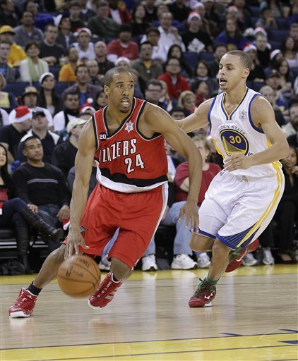 Andre Miller and his red shoes were not enough for Portland to get a Christmas day win in Oakland. Photo courtesy of the AP.