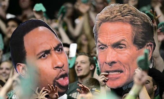 Feb 23, 2013; Fort Collins, CO, USA; Colorado State Rams fans hold large cut outs of ESPN television personality Stephen A. Smith (left) and Skip Bayless (right) during the game against the New Mexico Lobos at Moby Arena. The Lobos defeated the Rams 91-82. Mandatory Credit: Ron Chenoy-USA TODAY Sports