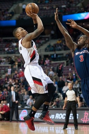Dec 15, 2013; Auburn Hills, MI, USA; Portland Trail Blazers point guard Damian Lillard (0) makes the game winning shot in overtime to defeat the Detroit Pistons 111-109 at the Palace of Auburn Hills. Mandatory Credit: Tim Fuller-USA TODAY Sports