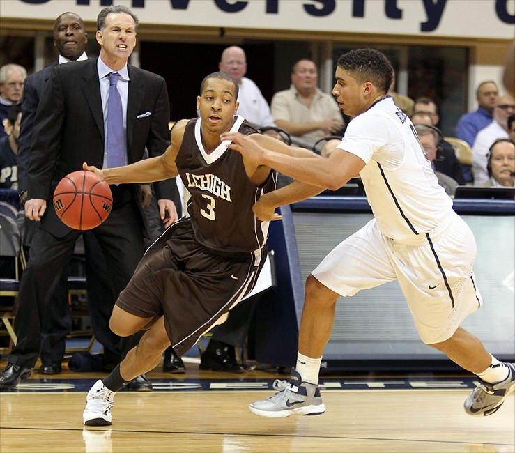 November 13, 2012; Pittsburgh, PA, USA; Lehigh Mountain Hawks guard C.J. McCollum (3) handles the ball against pressure by Pittsburgh Panthers guard James Robinson (right) during the first half at the Petersen Events Center. Mandatory Credit: Charles LeClaire-USA TODAY Sports