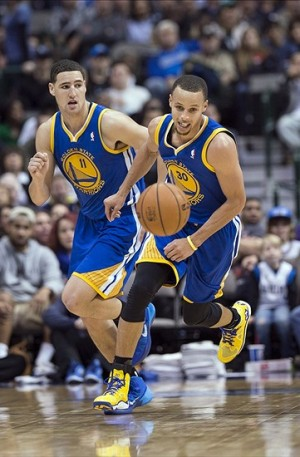 Nov 27, 2013; Dallas, TX, USA; Golden State Warriors shooting guard Klay Thompson (11) and point guard Stephen Curry (30) chase the ball during the second half against the Dallas Mavericks at the American Airlines Center. The Mavericks defeated the Warriors 103-99. Mandatory Credit: Jerome Miron-USA TODAY Sports