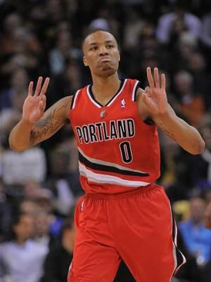 January 11, 2013; Oakland, CA, USA; Portland Trail Blazers point guard Damian Lillard (0) celebrates after making a three-point basket against the Golden State Warriors during the third quarter at Oracle Arena. The Warriors defeated the Trail Blazers 103-97. Mandatory Credit: Kyle Terada-USA TODAY Sports