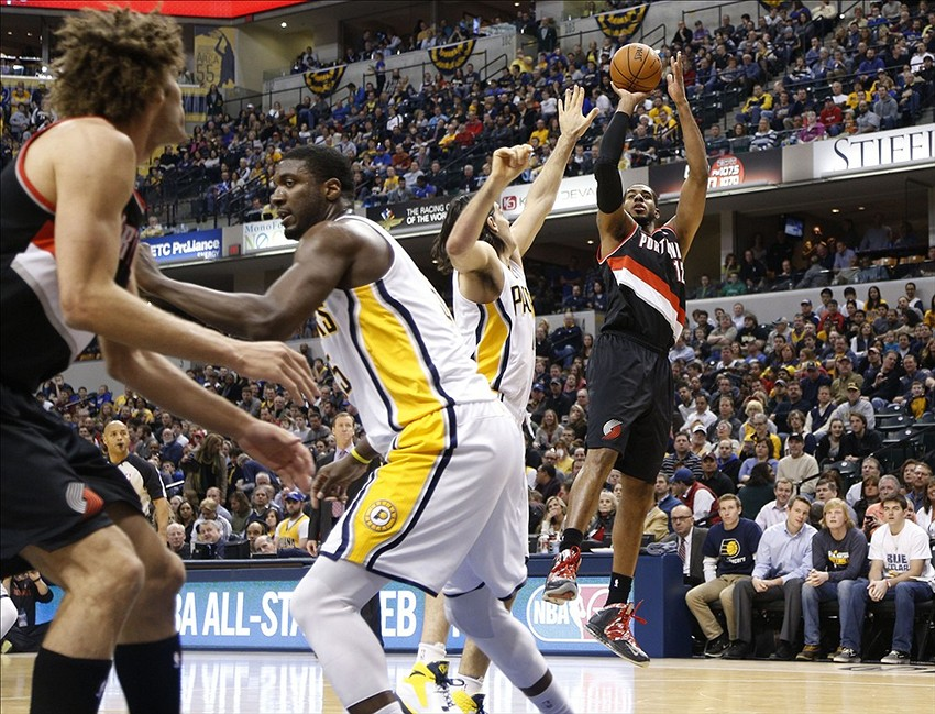 Feb 7, 2014; Indianapolis, IN, USA; Portland Trail Blazers forward LaMarcus Aldridge (12) takes a shot against Indiana Pacers forward Luis Scola (4) at Bankers Life Fieldhouse. Mandatory Credit: Brian Spurlock-USA TODAY Sports