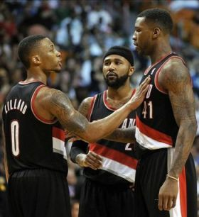 Mar 24, 2014; Miami, FL, USA; Portland Trail Blazers guard Damian Lillard (left) talks with forward Thomas Robinson (far right) and guard Wesley Matthews (center) during the second half against the Miami Heat at American Airlines Arena. Miami won 93-91. Mandatory Credit: Steve Mitchell-USA TODAY Sports