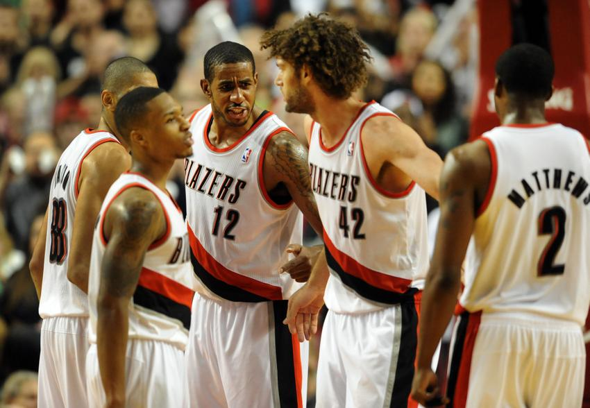 Dec 2, 2013; Portland, OR, USA; Portland Trail Blazers power forward LaMarcus Aldridge (12) speaks with small forward Nicolas Batum (88), point guard Damian Lillard (0), center Robin Lopez (42) and shooting guard Wesley Matthews (2) during the fourth quarter of the game against the Indiana Pacers at the Moda Center. The Blazers won the game 106-102. Mandatory Credit: Steve Dykes-USA TODAY Sports