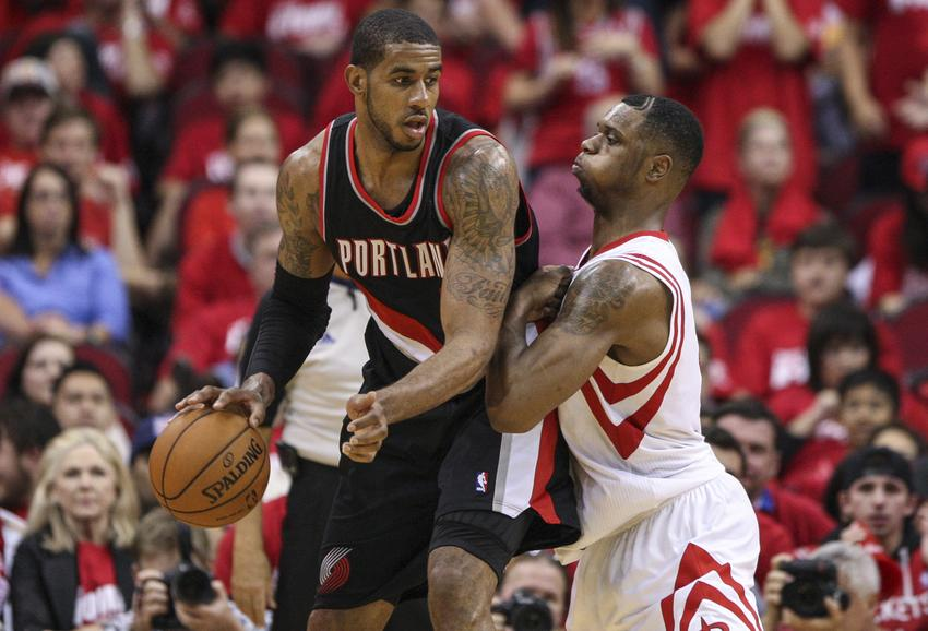 Apr 20, 2014; Houston, TX, USA; Portland Trail Blazers forward LaMarcus Aldridge (12) dribbles the ball during the fourth quarter as Houston Rockets forward Terrence Jones (6) defends in game one during the first round of the 2014 NBA Playoffs at Toyota Center. Mandatory Credit: Troy Taormina-USA TODAY Sports