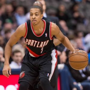 Jan 18, 2014; Dallas, TX, USA; Portland Trail Blazers shooting guard C.J. McCollum (3) brings the ball up court during the game against the Dallas Mavericks at the American Airlines Center. The Trail Blazers defeated the Mavericks 127-111. Mandatory Credit: Jerome Miron-USA TODAY Sports