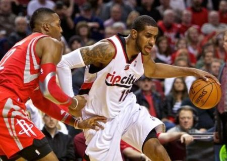 Apr 25, 2014; Portland, OR, USA; Portland Trail Blazers forward LaMarcus Aldridge (12) drives past Houston Rockets center Dwight Howard (12) during the second quarter in game three of the first round of the 2014 NBA Playoffs at the Moda Center. Mandatory Credit: Craig Mitchelldyer-USA TODAY Sports