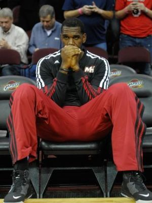 Mar 18, 2014; Cleveland, OH, USA; Miami Heat center Greg Oden (20) sits on the bench prior to a game against the Cleveland Cavaliers at Quicken Loans Arena. Miami won 100-96. Mandatory Credit: David Richard-USA TODAY Sports