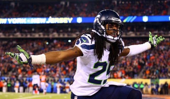 Feb 2, 2014; East Rutherford, NJ, USA; Seattle Seahawks cornerback Richard Sherman (25) reacts during the third quarter against the Denver Broncos in Super Bowl XLVIII at MetLife Stadium. Mandatory Credit: Mark J. Rebilas-USA TODAY Sports