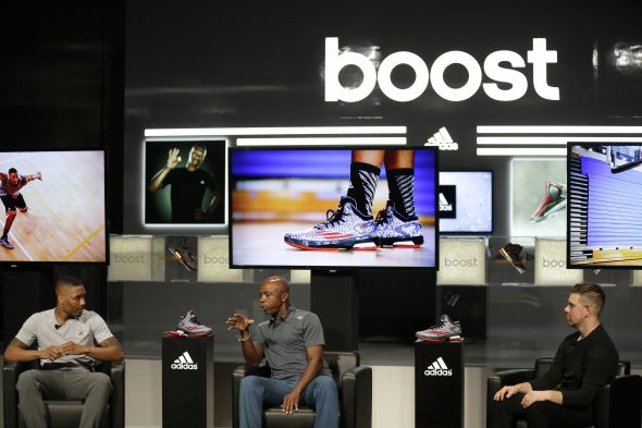 Las Vegas, Nevada (July 27, 2014) – Damian Lillard of the Portland Trail Blazers, former NBA player and broadcaster Greg Anthony and Robbie Fuller of adidas at the adidas Basketball Boost launch event at the MGM Grand Garden Arena.
