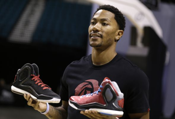 Las Vegas, Nevada (July 27, 2014) – Derrick Rose of the Chicago Bulls shows off the new adidas D Rose 5 Boost at the adidas Basketball Boost launch event at the MGM Grand Garden Arena.