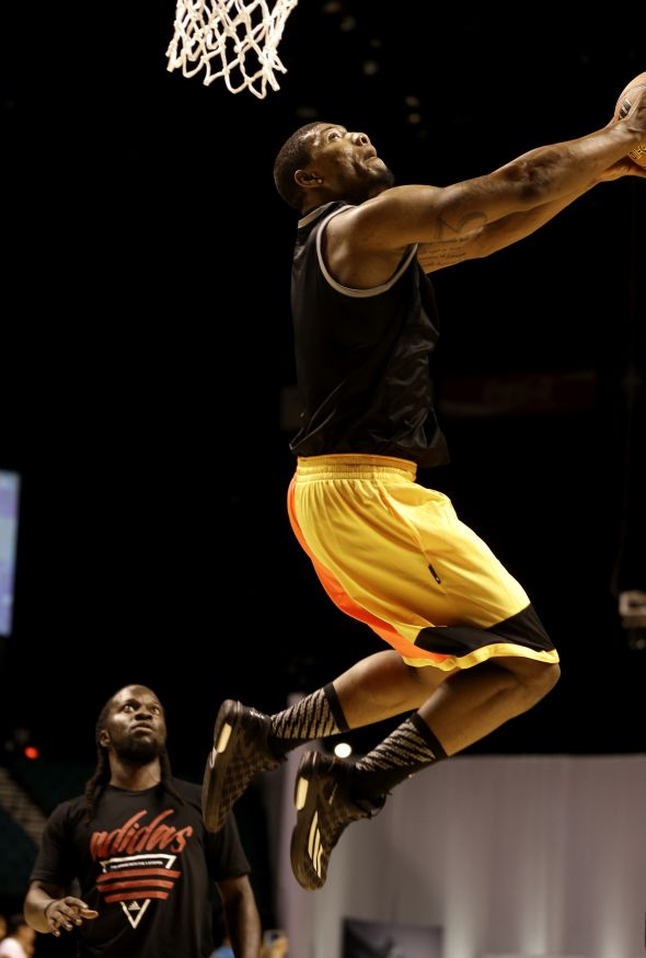 Las Vegas, Nevada (July 27, 2014) – Marcus Smart of the Boston Celtics goes up for a dunk during a pick-up game at the adidas Basketball Boost launch event at the MGM Grand Garden Arena.