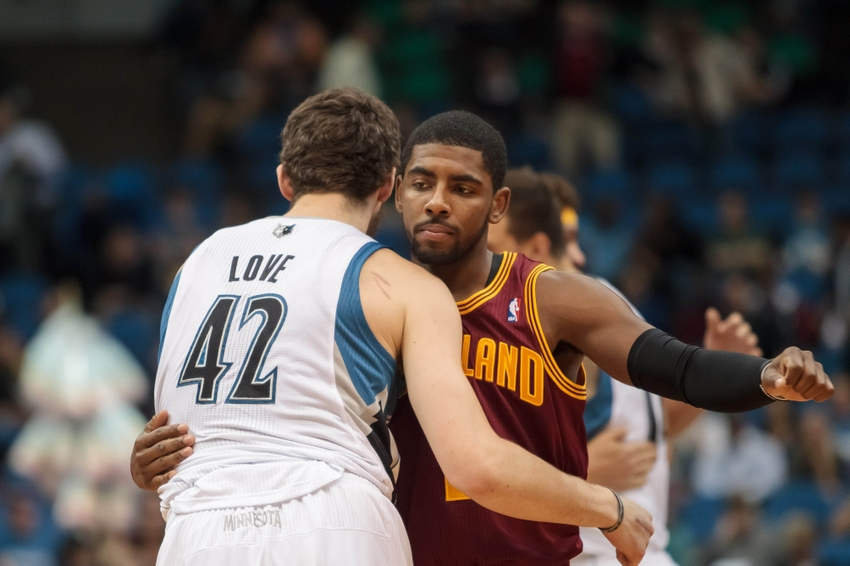 Nov 13, 2013; Minneapolis, MN, USA; Minnesota Timberwolves power forward Kevin Love (42) and Cleveland Cavaliers point guard Kyrie Irving (2) hug before the tip off at Target Center. Mandatory Credit: Brad Rempel-USA TODAY Sports
