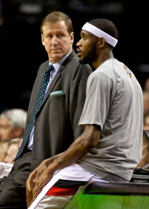 Mar 5, 2014; Portland, OR, USA; Portland Trail Blazers head coach Terry Stotts talks to shooting guard Will Barton (5) during a timeout against the Atlanta Hawks at the Moda Center. Mandatory Credit: Craig Mitchelldyer-USA TODAY Sports