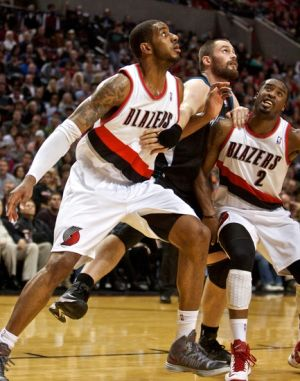Nov 23, 2012; Portland, OR, USA; Portland Trail Blazers power forward LaMarcus Aldridge (12) and shooting guard Wesley Matthews (2) box out Minnesota Timberwolves power forward Kevin Love (42) at the Rose Garden. Mandatory Credit: Craig Mitchelldyer-USA TODAY Sports