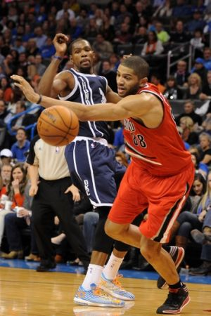 Dec 31, 2013; Oklahoma City, OK, USA; Portland Trail Blazers small forward Nicolas Batum (88) steals the ball from Oklahoma City Thunder small forward Kevin Durant (35) during the fourth quarter at Chesapeake Energy Arena. Mandatory Credit: Mark D. Smith-USA TODAY Sports