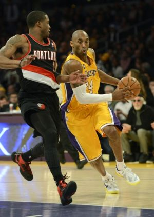 Feb 22, 2013; Los Angeles, CA, USA; Los Angeles Lakers shooting guard Kobe Bryant (24) drives against Portland Trail Blazers shooting guard Wesley Matthews (2) during the game at the Staples Center. Mandatory Credit: Richard Mackson-USA TODAY Sports
