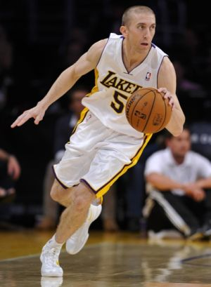 Nov 3, 2013; Los Angeles, CA, USA; Los Angeles Lakers point guard Steve Blake (5) brings the ball up court during the second half against theAtlanta Hawks at Staples Center. Mandatory Credit: Robert Hanashiro-USA TODAY Sports