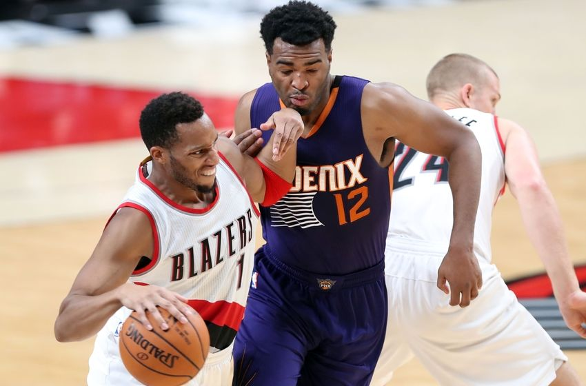 Oct 7, 2016; Portland, OR, USA; Portland Trail Blazers guard Evan Turner (1) fights off Phoenix Suns forward T.J. Warren (12) in the second half at Moda Center at the Rose Quarter. Mandatory Credit: Jaime Valdez-USA TODAY Sports