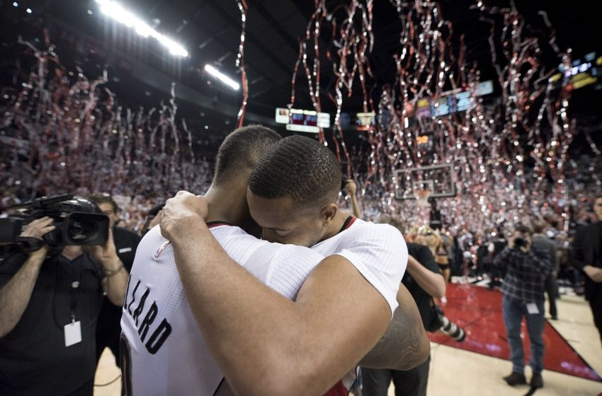 Apr 29, 2016; Portland, OR, USA; Portland Trail Blazers guard Damian Lillard (0) hugs guard CJ McCollum (3) after defeating the Los Angeles Clippers 106-103 in game six of the first round of the NBA Playoffs at Moda Center at the Rose Quarter. Mandatory Credit: Troy Wayrynen-USA TODAY Sports