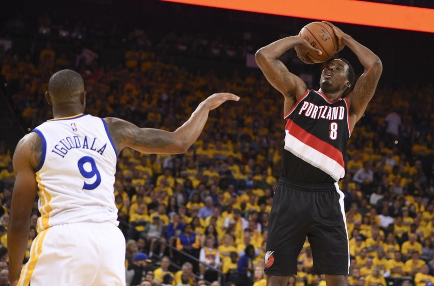 May 3, 2016; Oakland, CA, USA; Portland Trail Blazers forward Al-Farouq Aminu (8) shoots the basketball against Golden State Warriors forward Andre Iguodala (9) during the second quarter in game two of the second round of the NBA Playoffs at Oracle Arena. Mandatory Credit: Kyle Terada-USA TODAY Sports