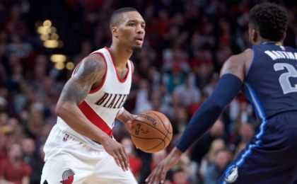 Dec 21, 2016; Portland, OR, USA; Portland Trail Blazers guard Damian Lillard (0) looks to pass around Dallas Mavericks guard Wesley Matthews (23) during the fourth quarter at the Moda Center. Mandatory Credit: Craig Mitchelldyer-USA TODAY Sports