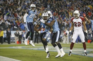 Nov 29, 2009; Nashville, TN, USA; Tennessee Titans wide receiver Nate Washington (85) and wide receiver Lavelle Hawkins (87) congradulate teammate Kenny Britt (18) on his game winning touchdown reception during the second half at on the Titans 20-17 win over the Arizona Cardinals at LP Field. Mandatory Credit: Charles Small-US PRESSWIRE