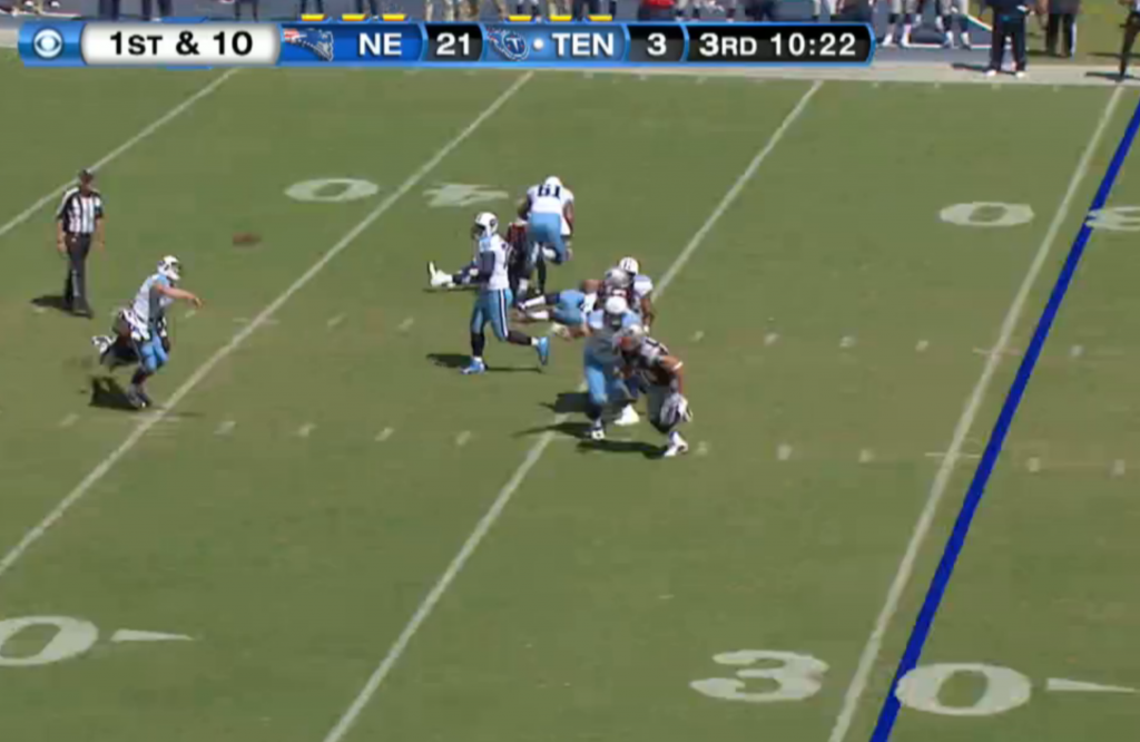 Jake Locker fires the ball downfield as Jones brings him down.