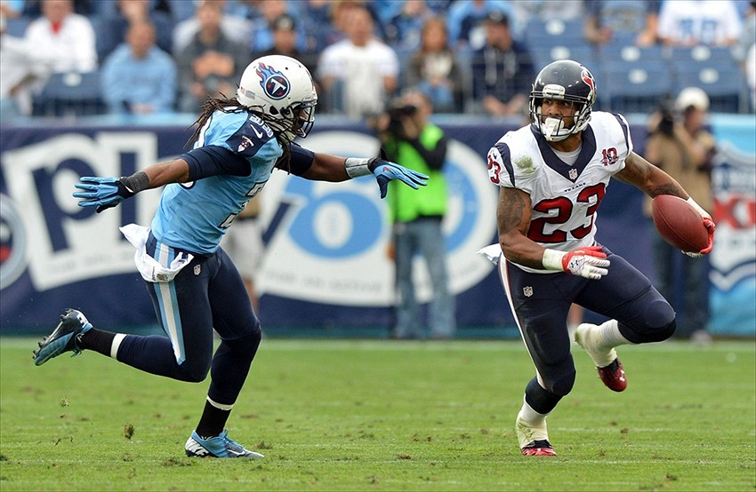 Dec 2, 2012; Nashville, TN, USA; Houston Texans running back Arian Foster (23) carries the ball against Tennessee Titans safety Michael Griffin (33) during the second half at LP Field. The Texans beat the Titans 24-10. Mandatory credit: Don McPeak-US Presswire