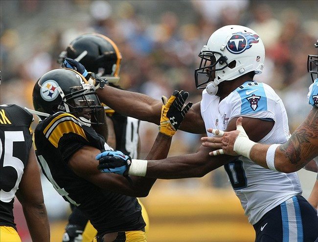Sep 8, 2013; Pittsburgh, PA, USA; Pittsburgh Steelers cornerback Ike Taylor (24) and Tennessee Titans wide receiver Kenny Britt (18) exchange shoves during the first half at Heinz Field. Mandatory Credit: Jason Bridge-USA TODAY Sports