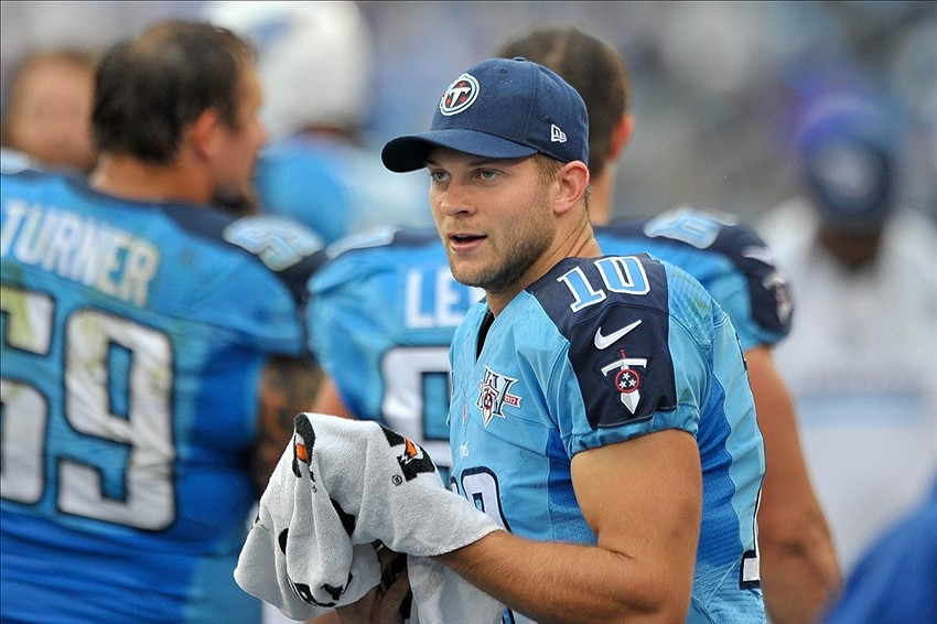 Sep 29, 2013; Nashville, TN, USA; Tennessee Titans quarterback Jake Locker (10) on the sideline against the New York Jets during the first half at LP Field. Tennessee won 38-13. Mandatory Credit: Jim Brown-USA TODAY Sports