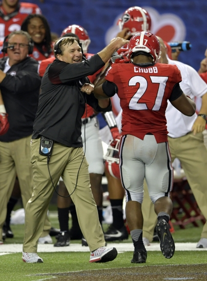 Sep 3, 2016; Atlanta, GA, USA; Georgia Bulldogs running back Nick Chubb (27) celebrates with head coach Kirby Smart after running for a touchdown against the North Carolina Tar Heels during the fourth quarter of the 2016 Chick-Fil-A Kickoff game at Georgia Dome. Mandatory Credit: Dale Zanine-USA TODAY Sports