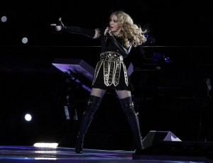 Madona pretending to shoot he agent for getting her to agree to do the Super Bowl Halftime Show. Credit: William Perlman-US PRESSWIRE