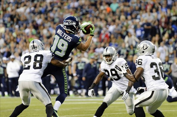 Aug 29, 2013; Seattle, WA, USA; Seattle Seahawks wide receiver Bryan Walters (19) catches a pass in front of Oakland Raiders cornerback Phillip Adams (28) during the 1st half at CenturyLink Field. Mandatory Credit: Steven Bisig-USA TODAY Sports