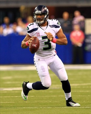 Oct 6, 2013; Indianapolis, IN, USA; Seattle Seahawks quarterback Russell Wilson (3) scrambles with the ball against the Indianapolis Colts at Lucas Oil Stadium. Mandatory Credit: Pat Lovell-USA TODAY Sports