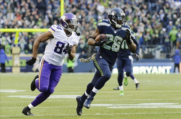 Nov 17, 2013; Seattle, WA, USA; Seattle Seahawks cornerback Walter Thurmond (28) runs the ball in for a touchdown after intercepting a pass by Minnesota Vikings quarterback Christian Ponder (7) (not pictured) during the second half at CenturyLink Field. Seattle defeated Minnesota 41-20. Mandatory Credit: Steven Bisig-USA TODAY Sports