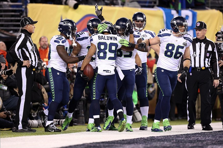 Feb 2, 2014; East Rutherford, NJ, USA; Seattle Seahawks wide receiver Doug Baldwin (89) celebrates his touchdown with teammates against the Denver Broncos during the fourth quarter in Super Bowl XLVIII at MetLife Stadium. Mandatory Credit: Matthew Emmons-USA TODAY Sports