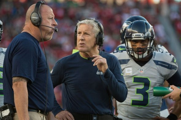 October 22, 2015; Santa Clara, CA, USA; Seattle Seahawks assistant head coach/offensive line coach Tom Cable (left), head coach Pete Carroll (center), and quarterback Russell Wilson (3) during the first quarter against the San Francisco 49ers at Levi