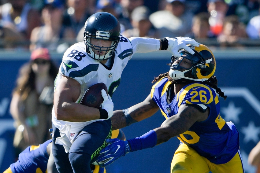 Sep 18, 2016; Los Angeles, CA, USA; Seattle Seahawks tight end Jimmy Graham (88) rushes against Los Angeles Rams outside linebacker Mark Barron (26) during the second half of a NFL game at Los Angeles Memorial Coliseum. Los Angeles won 9-3. Mandatory Credit: Kirby Lee-USA TODAY Sports