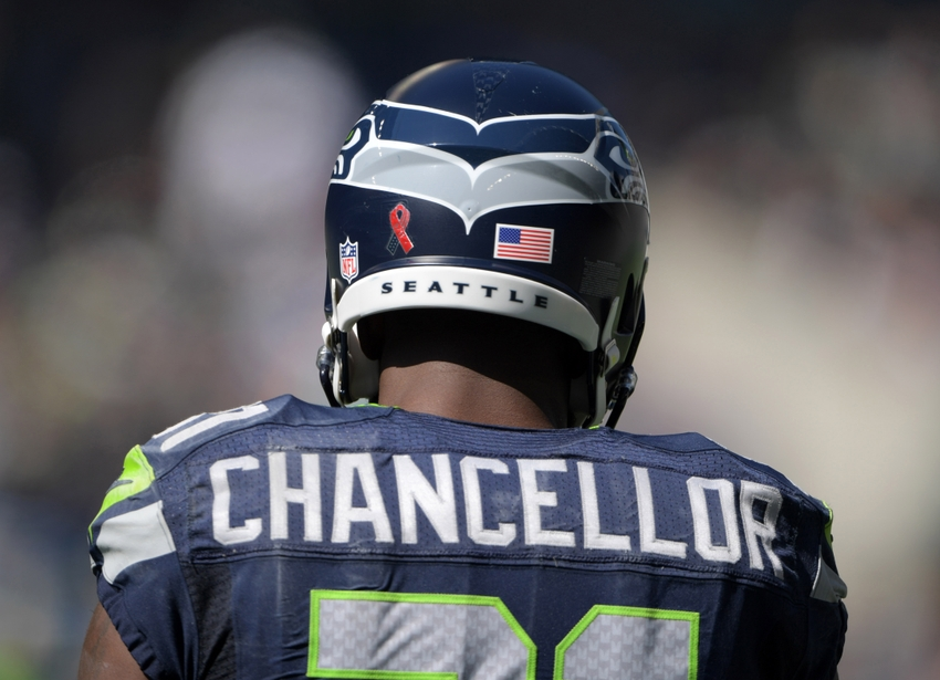 Sep 11, 2016; Seattle, WA, USA; Seattle Seahawks strong safety Kam Chancellor (31) wears sticker to recognize the 15th anniversary of 9/11 during a NFL game against the Miami Dolphins at CenturyLink Field. Mandatory Credit: Kirby Lee-USA TODAY Sports
