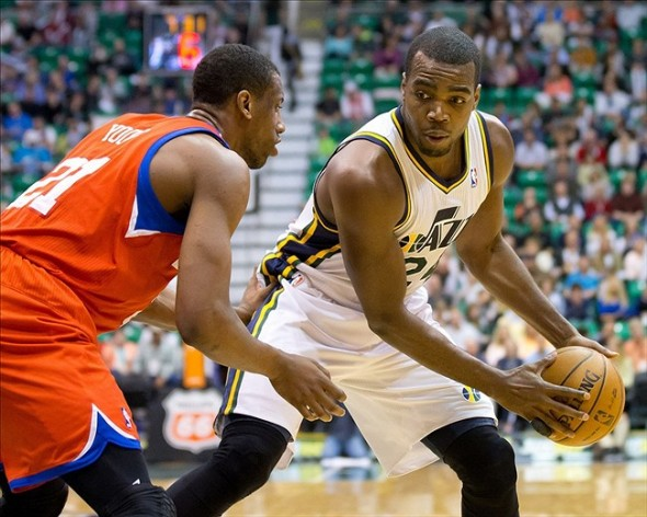 Mar 25, 2013; Salt Lake City, UT, USA; Utah Jazz power forward Paul Millsap (24) is defended by Philadelphia 76ers small forward Thaddeus Young (21) during the second half at EnergySolutions Arena. The Jazz won 107-91. Mandatory Credit: Russ Isabella-USA TODAY Sports